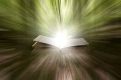 Book of powers. Open book with powerful magical light rays Stock Photography