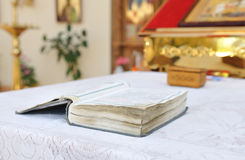 The book with the prayers on the table. Stock Photo