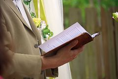 Wedding vows of preacher with book royalty free stock photography