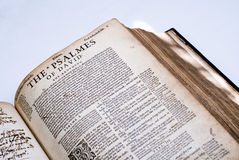 The book of Psalmes in Old English. An open bible, at the book of Psalms, written in Old English, with a white background Stock Photography