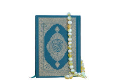 The book Quran and prayer beads stock photo