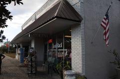 BOOK RACK STORE AND XMAS SANTA. OCOEE/ORLANDO / FLORIDA / USA - 01 December 2017. _Book rack store and christmas season in american village. Photo.Francis Dean/ Stock Photo