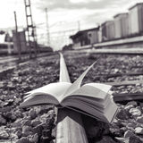 Book on the railroad tracks, black and white Royalty Free Stock Photo