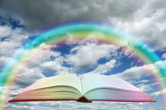 Book and rainbow Stock Photo