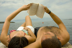 Book reading couple in Holiday  Royalty Free Stock Photo