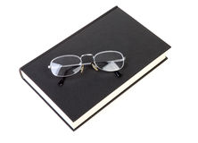 Book with reading glasses Royalty Free Stock Image