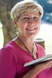 book reading senior woman Стоковая Фотография
