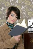 Book reading woman retro vintage wallpaper room Royalty Free Stock Photo