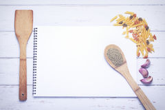 Book of recipes. With ingredients on a table Stock Photos