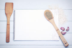 Book of recipes. With ingredients on a table Stock Images