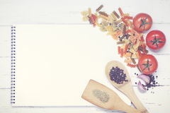 Book of recipes. With ingredients on a wooden table Stock Photo