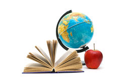 Book, red apple and globe on white background Royalty Free Stock Image