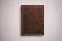The book in a red cover on a light gray background Royalty Free Stock Images