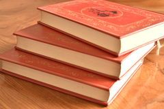 Book with a red cover three books stock photos