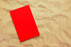 Book with red covers on summer vacation beach holiday Stock Images