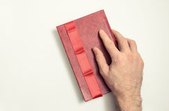 Book, red ribbon, and hand. On a white background Royalty Free Stock Photography