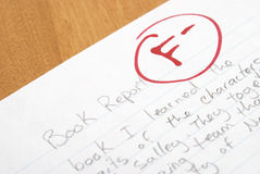 Book Report. A handwritten book report is given an F for poor work stock image
