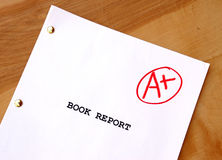 A+ Book Report. A book report on a desk with a perfect grade Stock Photography