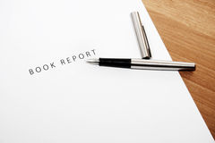 Book report. And pen Stock Photos