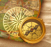 Book with retro golden compass Stock Photo