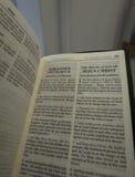 Book of Revelation. Aka Apocalypse or Revelation of John in Swedish and English Stock Photo