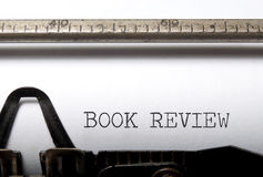 Book review. Printed on a vintage typewriter stock photos