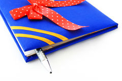 Book with ribbon and pen Stock Images