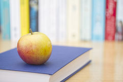 Book with ripe apple Stock Image