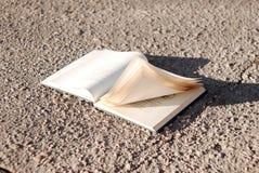 Book at road Stock Photo