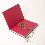 Book and rosary Stock Photo