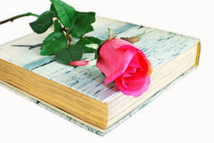 Book and rose Stock Photography