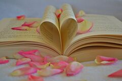 Book with rose petals Royalty Free Stock Image