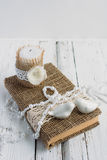 The book is in rustic style on a white table. With a candle and a pearl necklace Stock Photos