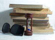 Book sand clock glasses in still life concept Royalty Free Stock Photos
