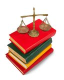 Book and scales of justice over white background Royalty Free Stock Image