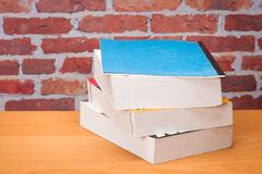 Book for school. In front of brick wall Royalty Free Stock Photography