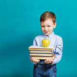 Book, school, kid. little student holding books. Cheerful smilin Royalty Free Stock Photo
