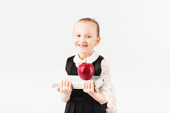Book, school, kid. smiling little girl with big backpack holding Royalty Free Stock Photos