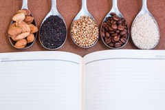 Book and seeds ingredient for background Royalty Free Stock Photos