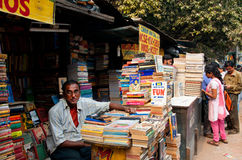 Book seller waiting for the customerson the street market in Kolkata Stock Images