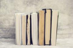 Book series on concrete shelf Stock Photo
