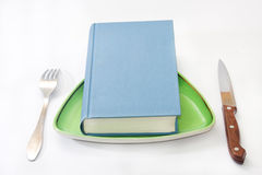 Book served on the plate with fork and knife Royalty Free Stock Images