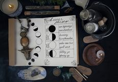 Book of Shadows with lunar phases on black altar. royalty free stock image