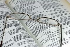 Book by Shakespeare and glasses. A pair of reading glasses and a book showing pages of Shakespeare's Macbeth Royalty Free Stock Photos