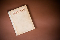 Book by Shakespeare. Old Book by Shakespeare on Vintage Background Stock Images