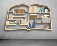 Book shape bookshelf on concrete wall Royalty Free Stock Images