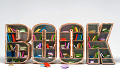 Book Shelve. 3d image of colorful book in shelve in shape of book word Stock Photography