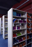 Book shelves in the library Stock Images