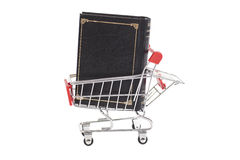 Book in shopping cart  on white Stock Photography