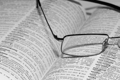 Book with Spectacles. Open Book with Spectacles on the book Royalty Free Stock Image
